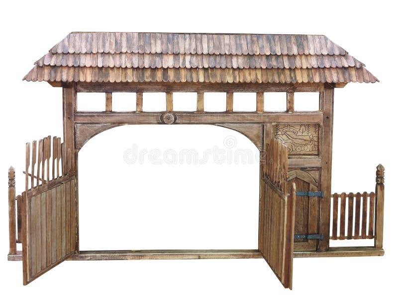 Il portone di legno fatto a mano antico decorato con il modello ha isolato il ove fotografia stock libera da diritti