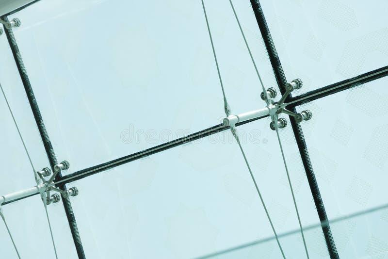 Il primo piano del ragno preme il montaggio degli strati di vetro fotografia stock libera da diritti