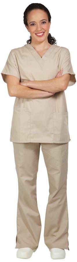 Il professionista medico ispano con le armi ha attraversato, sorridendo fotografie stock