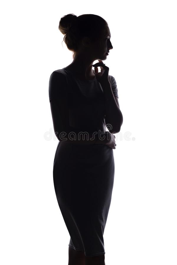 Il profilo della siluetta della donna dipende il fondo isolato bianco immagini stock libere da diritti