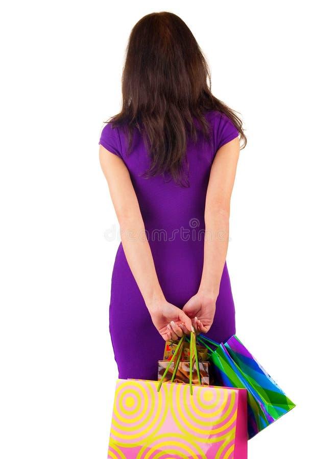 Il punto di vista posteriore di bella donna con shoping insacca lo sguardo fotografie stock libere da diritti