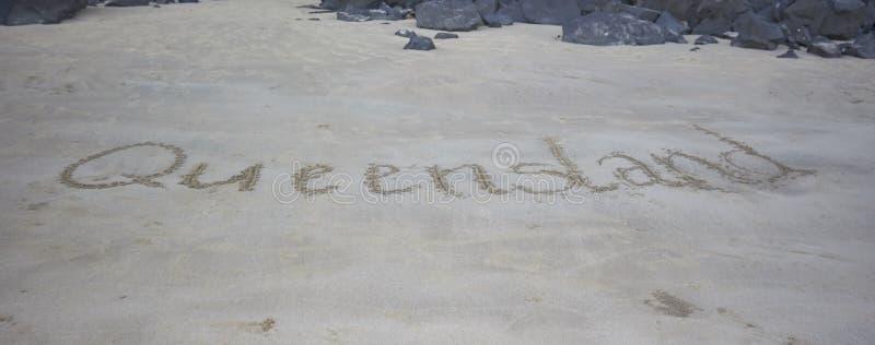 Il Queensland scritto nella sabbia fotografia stock libera da diritti