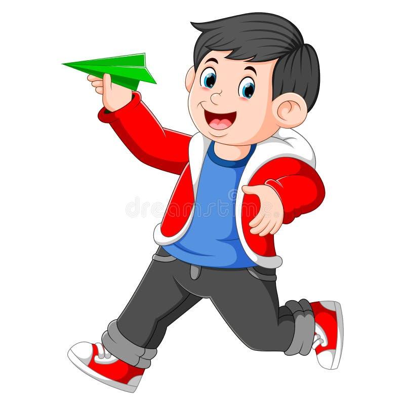 Il ragazzo che per mezzo del rivestimento rosso sta tenendo l'aereo di Libro Verde royalty illustrazione gratis