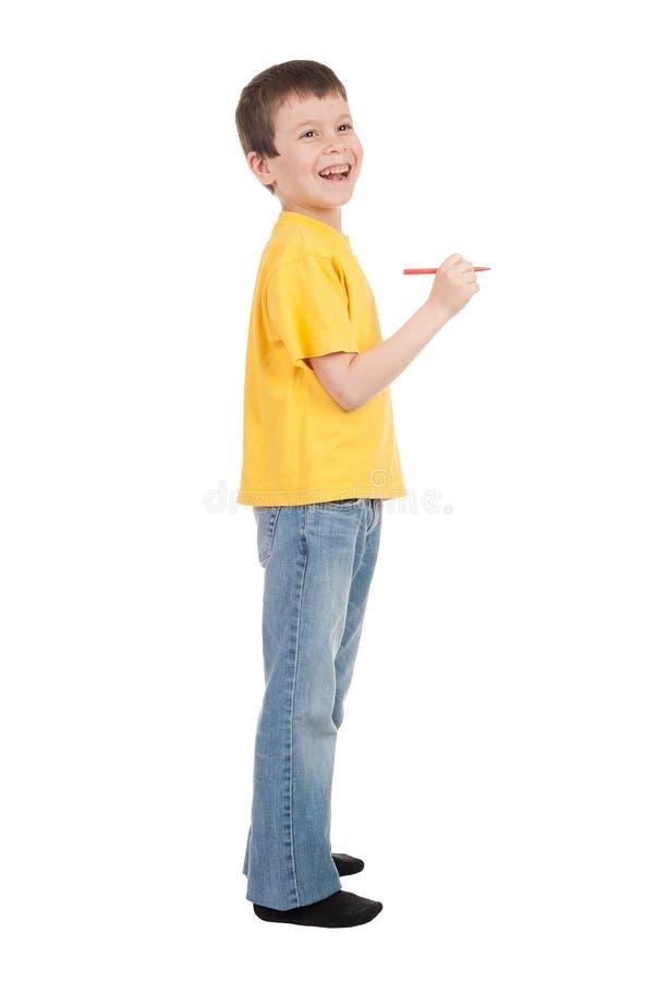Download Il Ragazzo In Maglietta Gialla Scrive Fotografia Stock - Immagine di bambino, isolato: 30831118