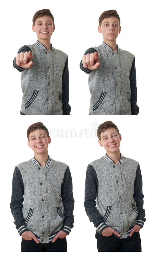 Il ragazzo sveglio dell'adolescente in maglione grigio sopra bianco ha isolato il fondo fotografie stock libere da diritti