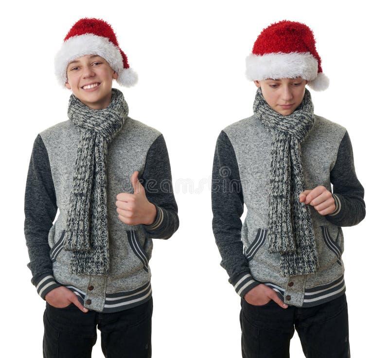 Il ragazzo sveglio dell'adolescente in maglione grigio sopra bianco ha isolato il fondo immagini stock libere da diritti