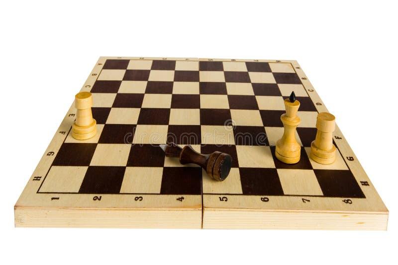 Il re nero di scacchi è sconfigguto e si trova sul bordo immagini stock libere da diritti
