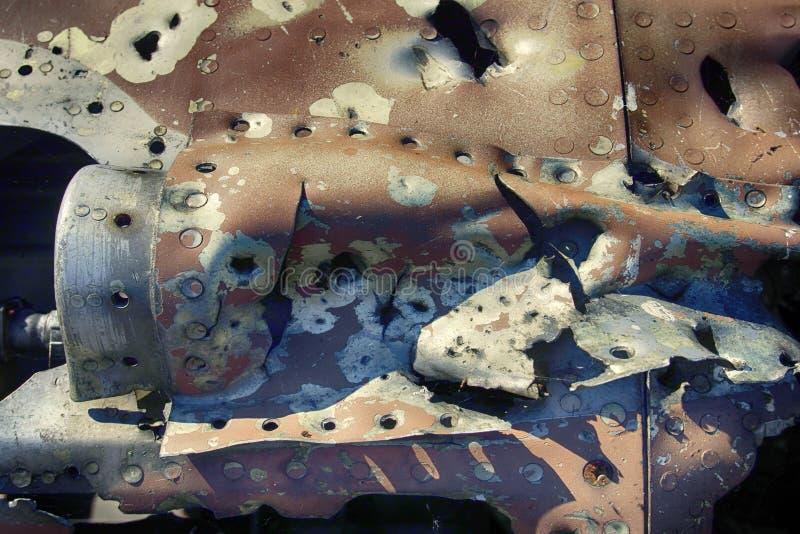 Il resti degli ærei militari ha perforato i frammenti di coperture, effetto della scheggia immagini stock libere da diritti