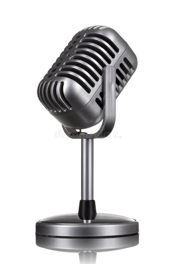 Il retro microfono ha isolato immagine stock
