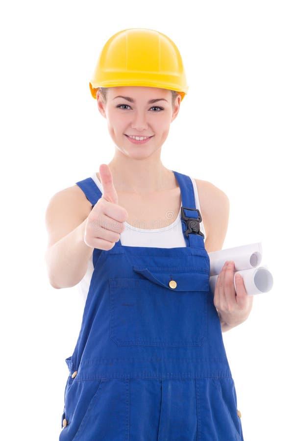 Il ritratto del costruttore felice della donna in tute blu sfoglia sull'isolante immagine stock libera da diritti