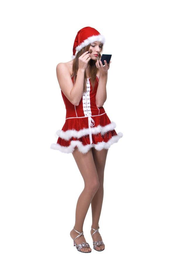 Il ritratto della ragazza nel fare del vestito dalla Santa compone immagine stock libera da diritti