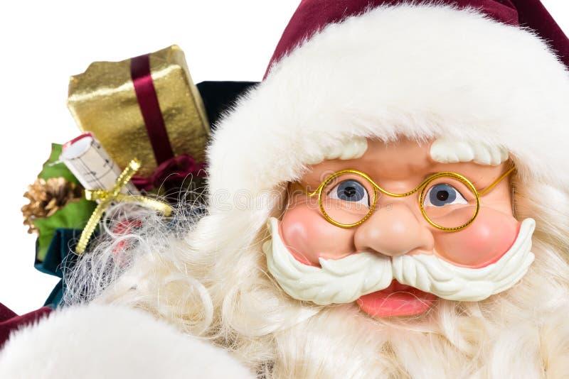 Il ritratto di Santa Claus affronta e presente fotografia stock