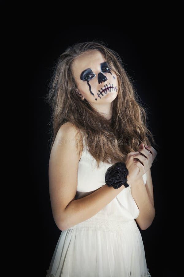 Il ritratto di una ragazza si è vestito per la celebrazione di Halloween immagine stock