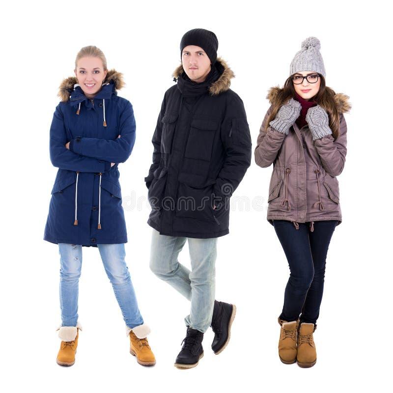 Il ritratto integrale del giovane e due donne nell'inverno coprono immagini stock libere da diritti