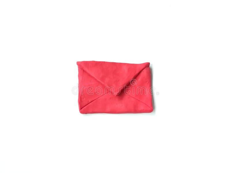 Il rosso avvolge l'argilla del plasticine, pasta sveglia, fondo bianco fotografie stock libere da diritti