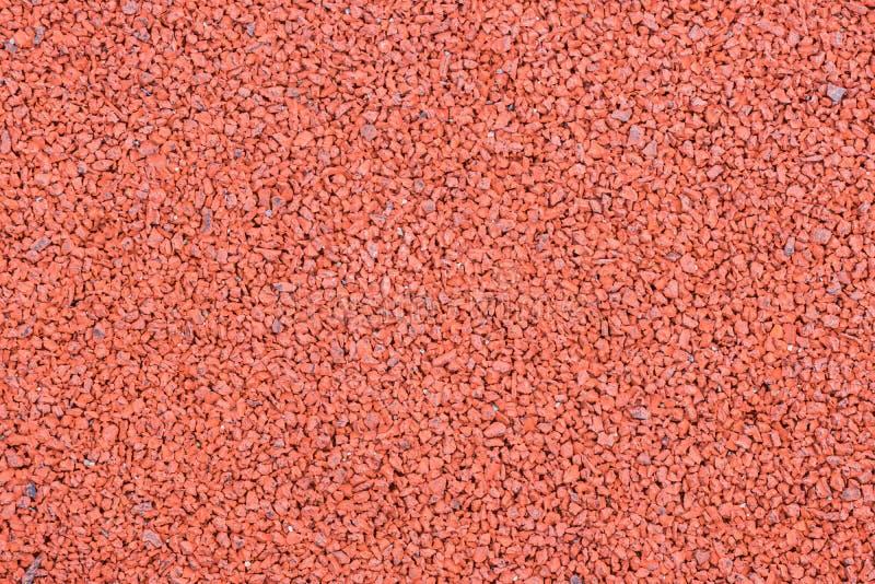 Il rosso ha dipinto la struttura di gomma del fondo della pavimentazione del campo da giuoco fotografia stock libera da diritti
