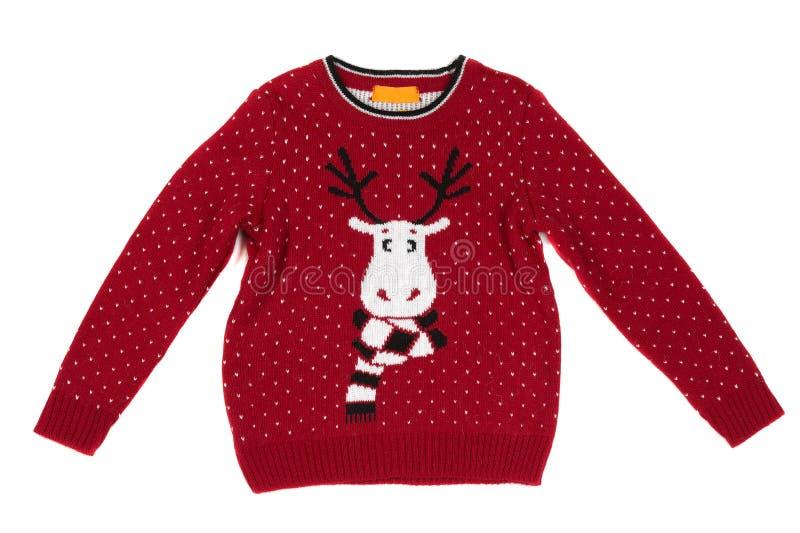 Il ` s dei bambini ha tricottato il maglione con un modello dei cervi Isolato su bianco fotografie stock libere da diritti