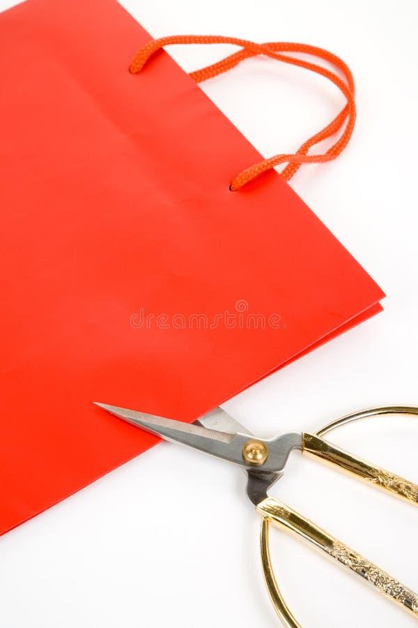 Il sacchetto di acquisto e scissor immagini stock