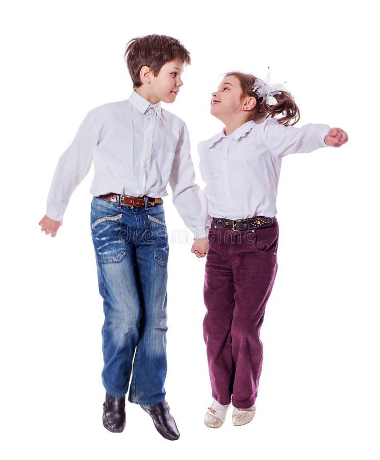 Il salto dei bambini isolato fotografia stock