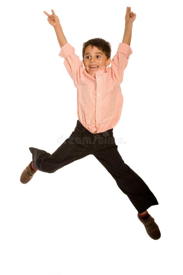 Il salto del ragazzino fotografia stock