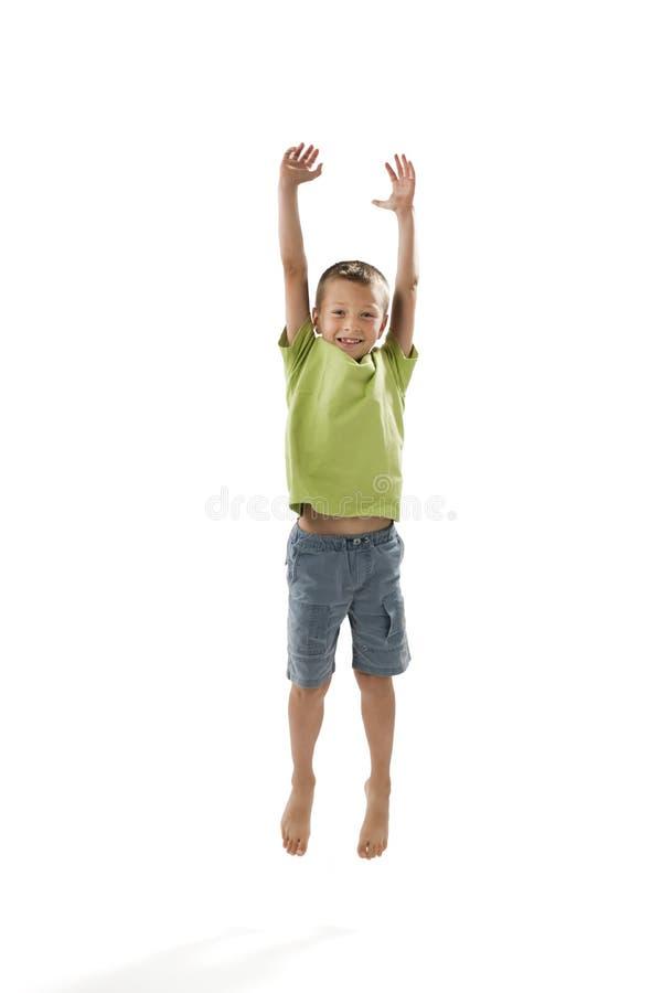 Il salto del ragazzino fotografie stock libere da diritti