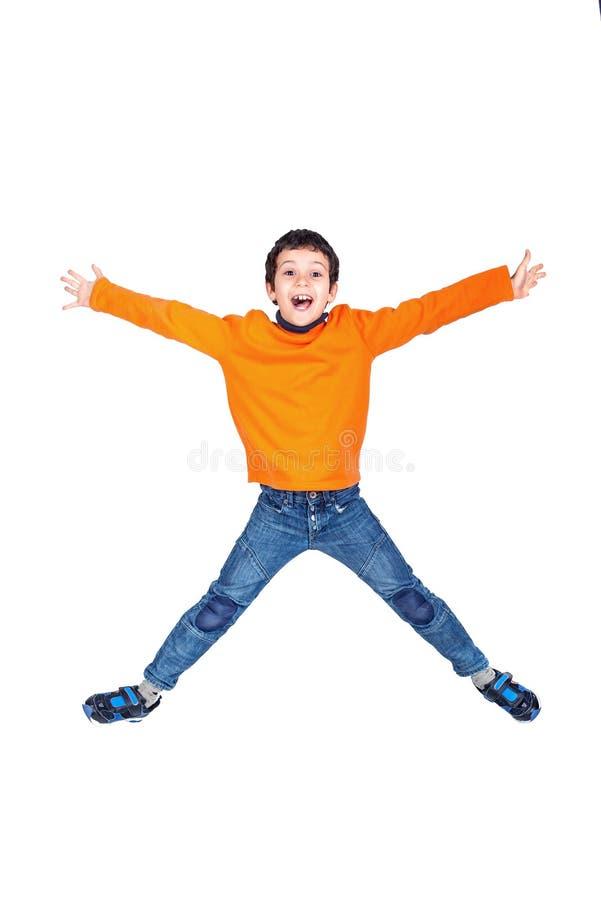 Il salto del ragazzo isolato nel bianco fotografia stock libera da diritti