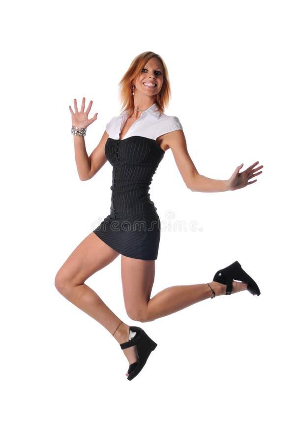 Il salto della donna di affari fotografie stock