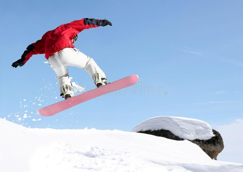 Il salto dello Snowboarder immagini stock