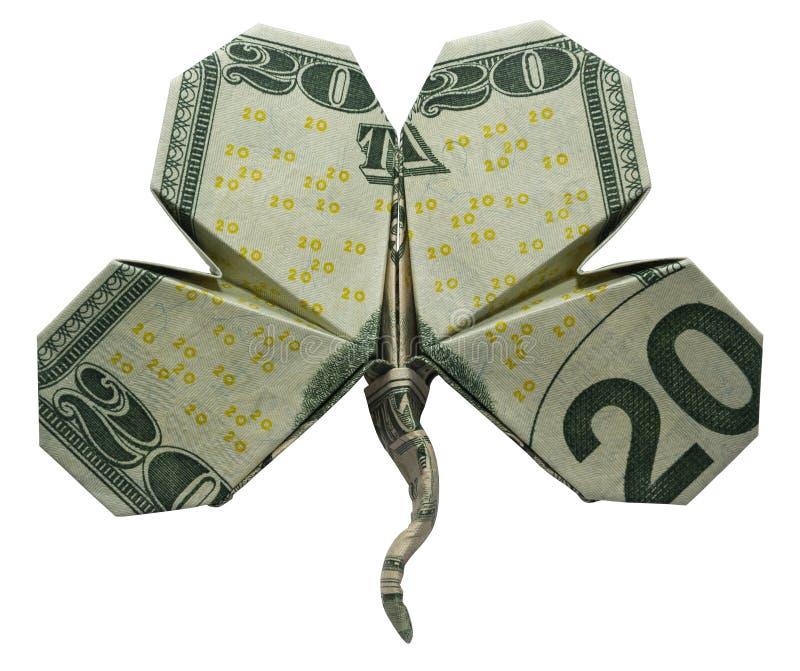 Il simbolo della foglia dell'acetosella del quadrifoglio di origami dei soldi ha piegato con i 20 dollari reali di Bill Isolated fotografie stock libere da diritti
