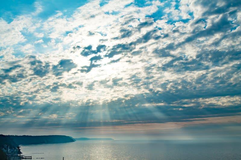 Il sole nelle nuvole fotografie stock libere da diritti