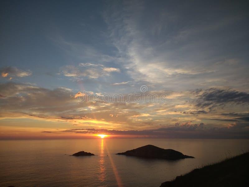 Il Sun va giù fotografia stock