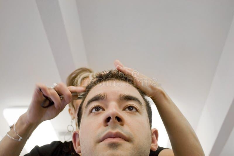 Il taglio di capelli fotografie stock