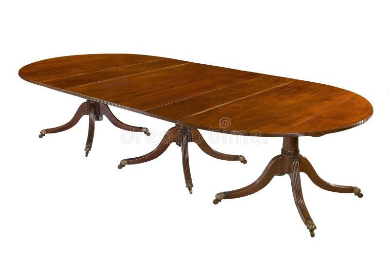 Il tavolo da pranzo completamente ha esteso il vecchio legno di mogano antico isolato immagine stock