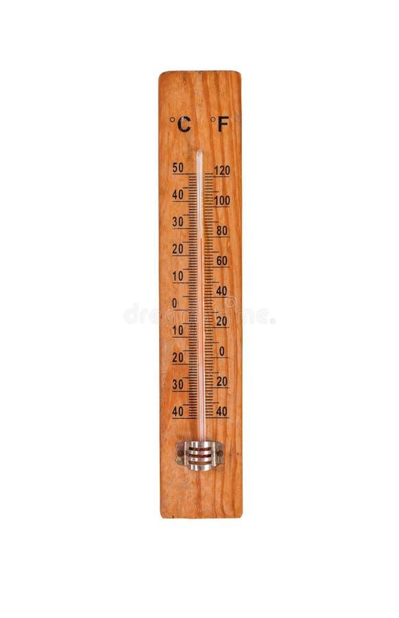 Il termometro sulla base di legno con i gradi di Fahrenheit e di Celsius riporta in scala, isolato su fondo bianco immagini stock
