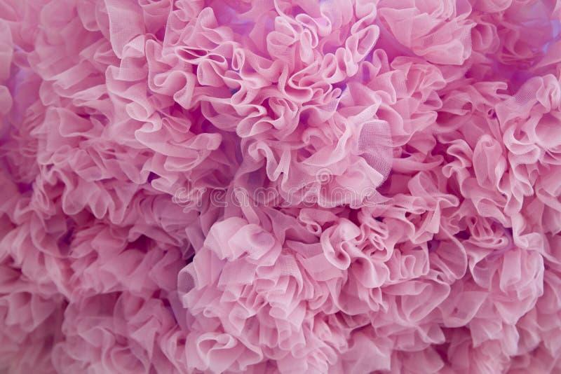 Il tessuto rosa increspa il fondo fotografia stock