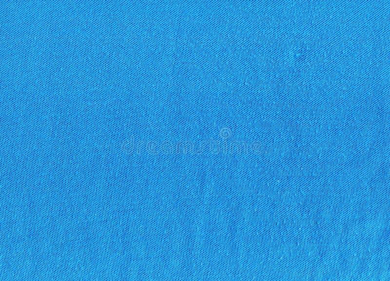Il tessuto struttura il fondo blu immagine stock
