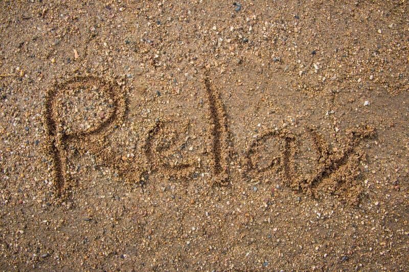 Il testo si rilassa sul sand1 fotografia stock