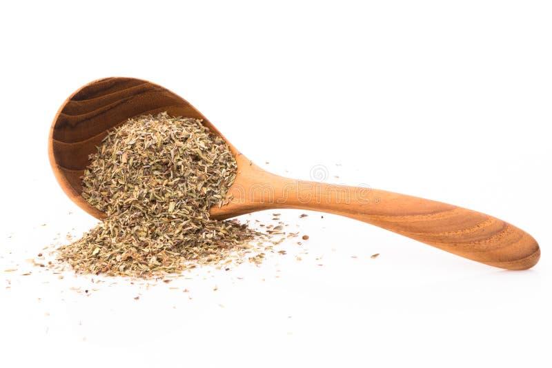 Il timo sul cucchiaio di legno, prepara la cottura dell'aumento piccante di diffusione fotografia stock libera da diritti