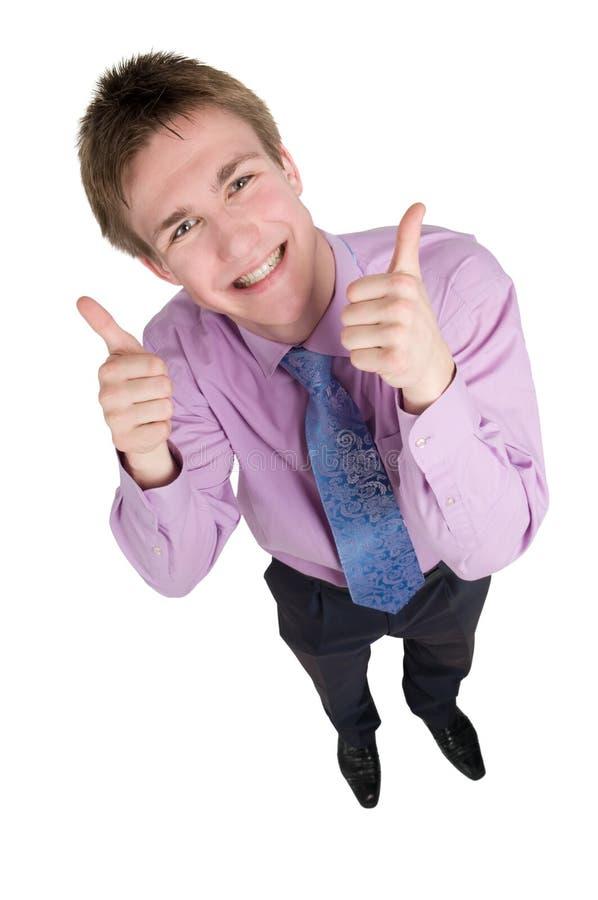 Il tirante di smiley con i pollici aumenta le mani fotografia stock