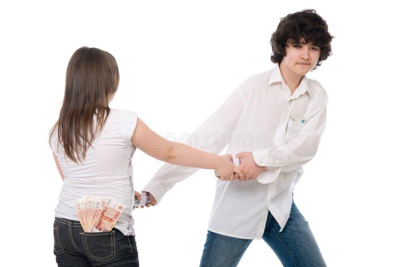 Il tirante e la ragazza non possono dividere i soldi fotografia stock