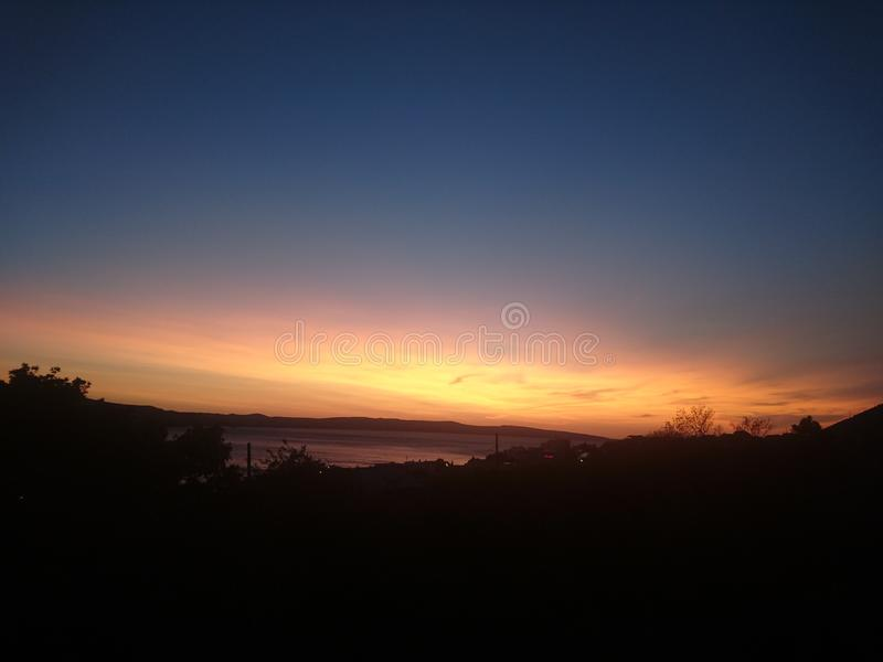 Il tramonto più vede lo slluette fotografia stock libera da diritti