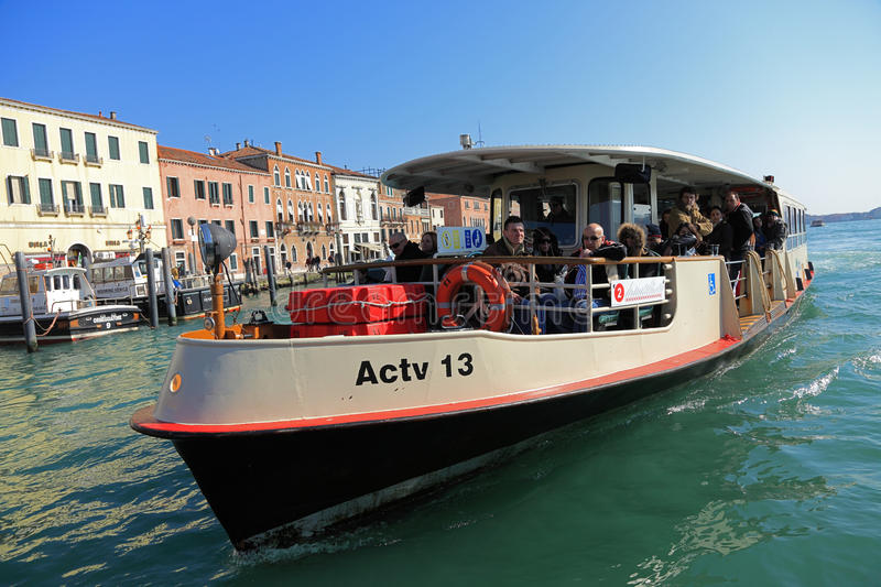 Il Vaporetto. Venice,Italy- February 26th, 2011: Image of Il Vaporeto with tourists sailing on the Grand Canal in Venice. Il Vaporeto is a motorised waterbus royalty free stock images