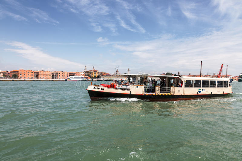 Il Vaporetto. Venice,Italy- July 28, 2011: Image of Il Vaporetto with tourists sailing on the Grand Canal in Venice. Il Vaporeto is a motorized waterbus which royalty free stock images