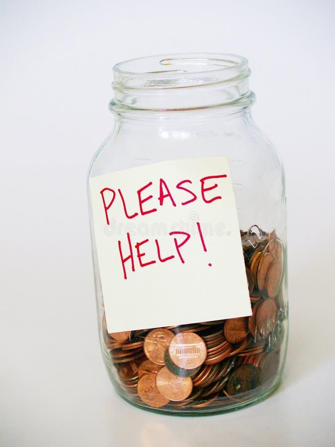 Il vaso in pieno dei penny con PREGO CONTRIBUISCE a firmare immagini stock libere da diritti