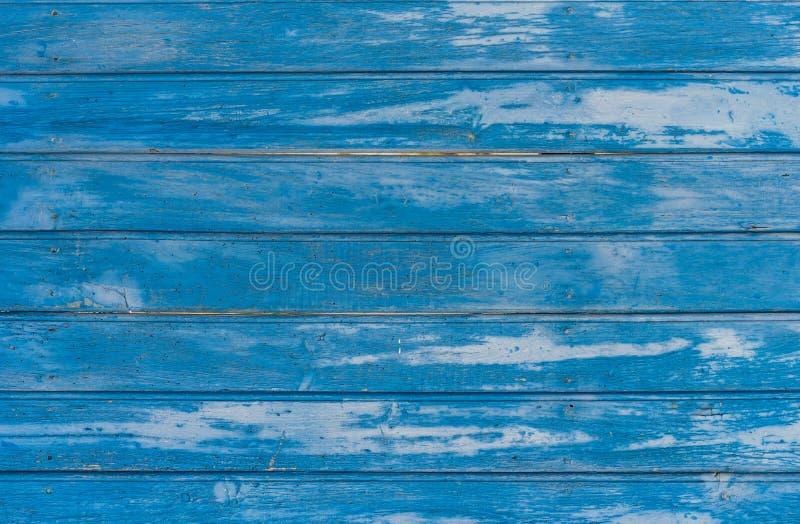 Il vecchio blu stagionato ha colorato la struttura di legno del fondo della parete fotografie stock