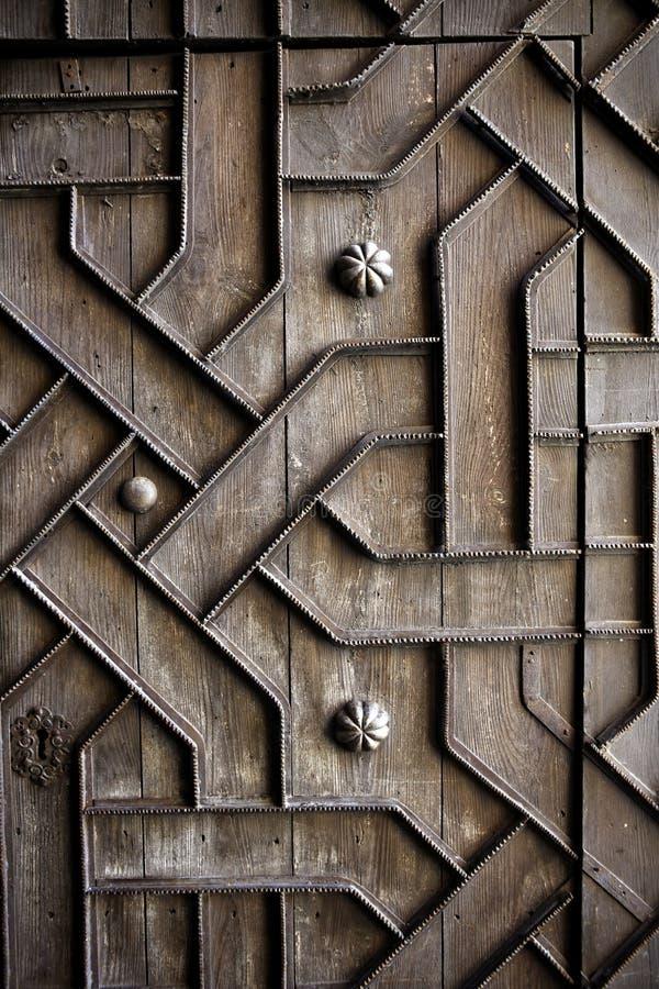 Il vecchio ferro di legno invecchiato del portello handcraft il deco fotografie stock