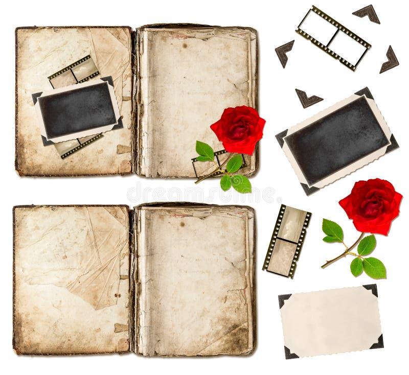 Il vecchio libro, i frameds della foto e la rosa rossa fioriscono Elementi dell'album fotografie stock