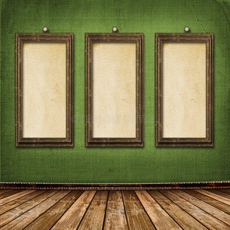 Il vecchio oro incornicia lo stile del Victorian sulla parete immagini stock