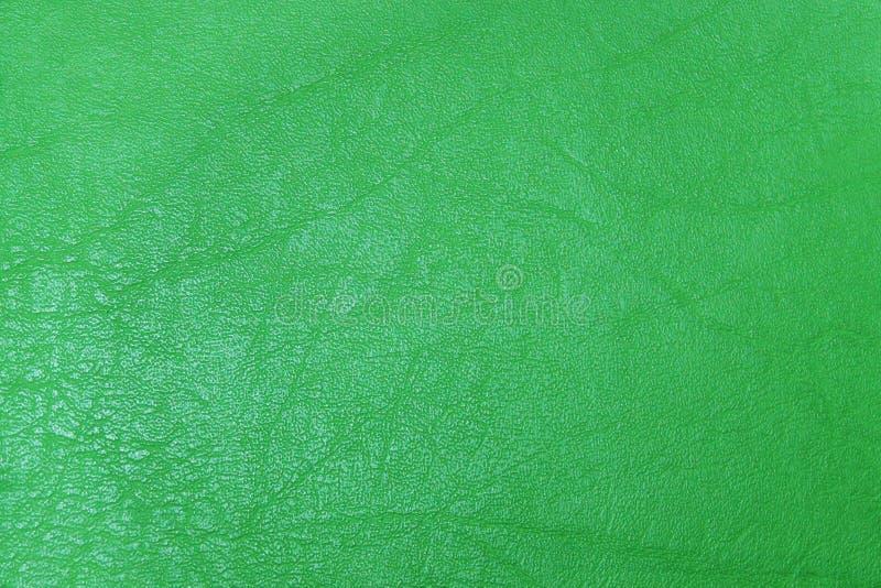 Il verde dell'estratto ha strutturato il fondo di cuoio fotografia stock