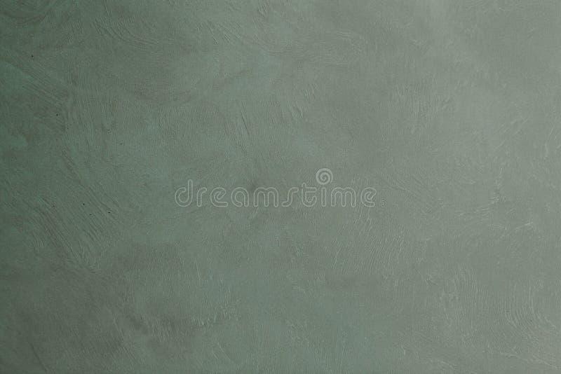 Il verde grigio ha dipinto il contesto dello studio del panno del tessuto della mussola o della tela fotografie stock